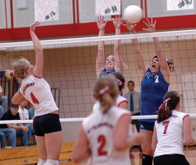Moffat County's Natasha Romney, left, and Alisha Camp try to block a swing from Steamboat's Kacey Bull on Thursday in Steamboat. The Sailors won the rivalry matchup, defeating Moffat County in three games.
