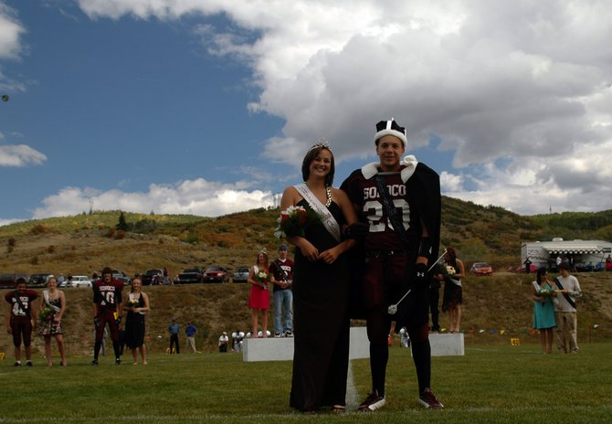 Sarajane Rossi and Mike Davis stand front and center Saturday in Oak Creek after they were named Soroco's homcoming king and queen. The crowning festivites took place before the Rams' football game, which they won, 57-22, against Nucla.