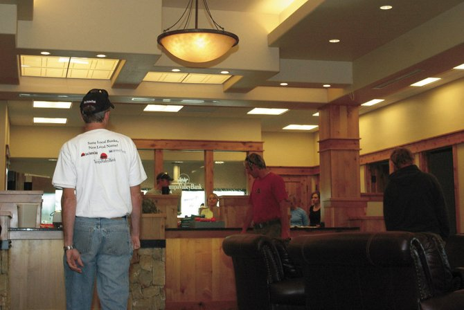 Yampa Valley Bank officials and APH Construction workers put finishing touches on the new Yampa Valley Bank Craig building lobby Saturday morning. The new building is about five times the size of the Craig location's previous offices, and it includes a conference room and space for up to three extra offices for potential lease.