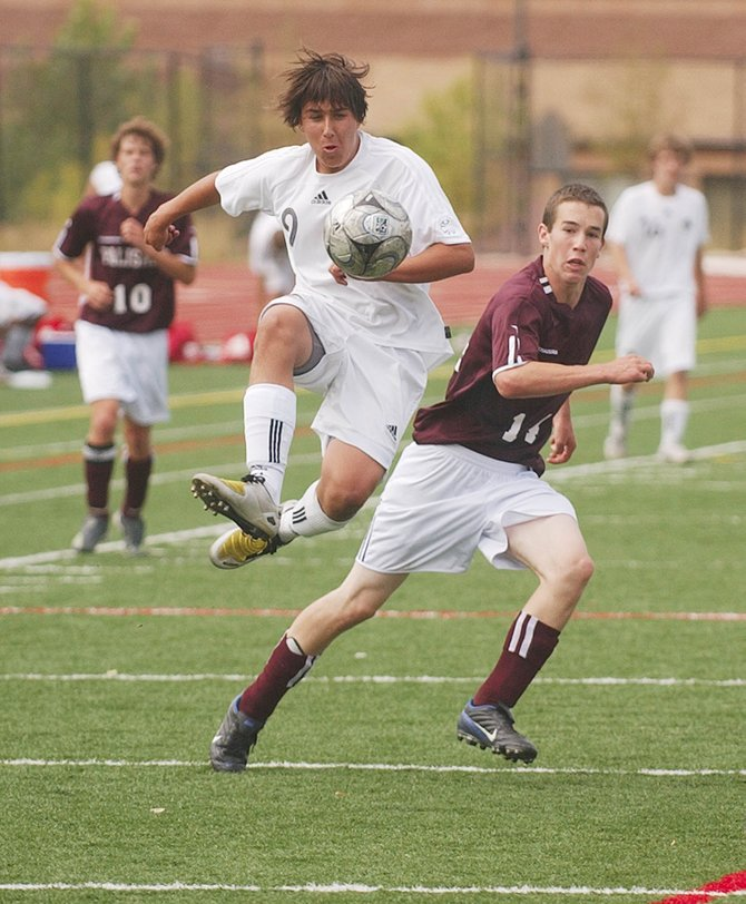 Steamboat Springs High School senior Daniel Wright jumps to get control of the ball Saturday during Steamboat's match against Palisade at Gardner Field. Steamboat won, 4-0.