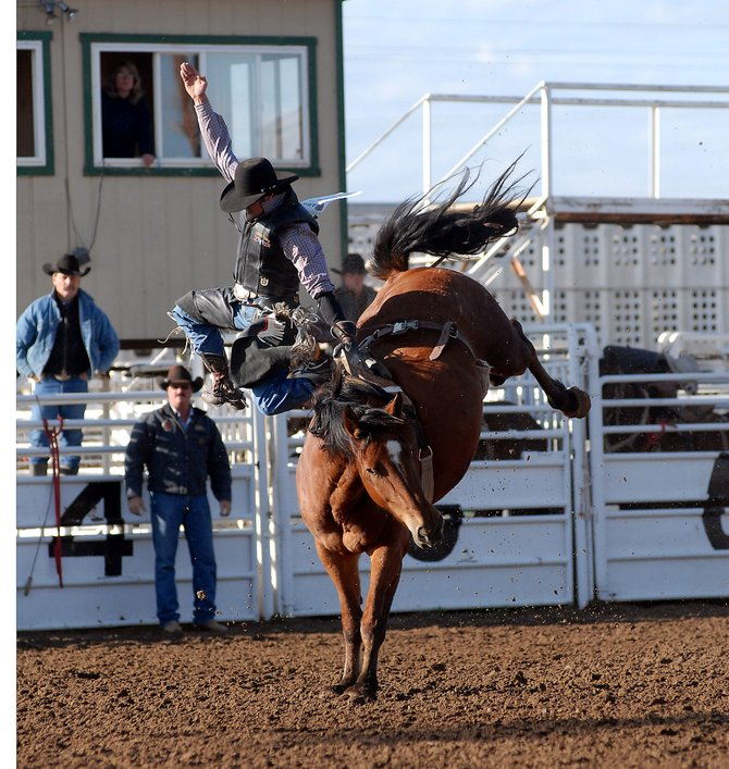 Moffat County High School senior Eric Fleming is bucked from his horse Saturday during the senior boy's bareback event at the Moffat County rodeo. Fleming failed to earn any points during the event, slipping to fifth-place in the all-around category entering the winter break.