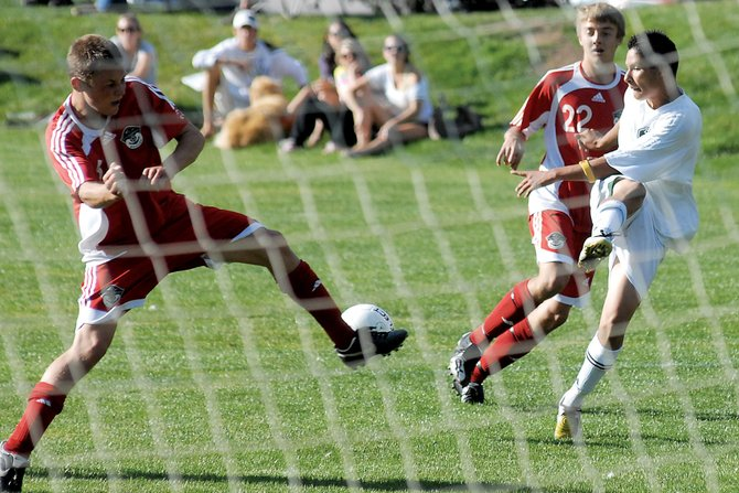 Steamboat Springs' Andrew White, left, and Christopher Holmquist defend the goal against a Battle Mountain High School player Tuesday in Eagle-Vail.