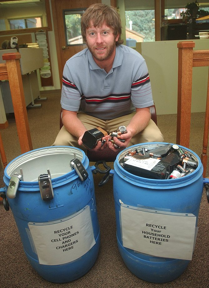Steamboat Springs City Planner and Green Team coordinator Bob Keenan sits with the community cell phone and battery recycling containers located at City Hall.