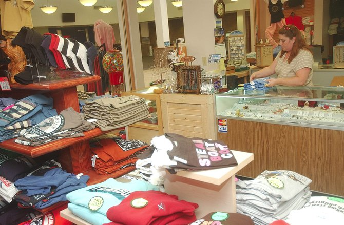 Tammie Hintze folds T-shirts on Tuesday afternoon at the gift shop in the Yampa Valley Regional Airport.