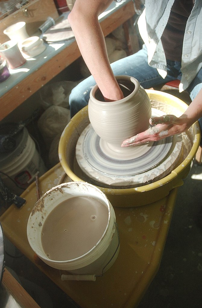 Steamboat artist Julie Anderson works on a clay jar Wednesday at her studio.