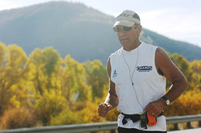 Marshall Ulrich runs east along U.S. Highway 40 toward Steamboat Springs on Wednesday. Ulrich is attempting a record-setting run across the U.S. in 45 days.