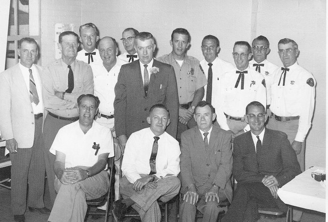 This is a photo of the members of the Moffat County Sheriff's Posse taken in 1961. Pictured, front row, from left, are: Paul Duncan, Worth Shrimpton, John W. Davis and Hugh Jones; back row, from left: Bill Roland, Corrin Davidson, Doyle Jackson, Roy Burner, Conway Irick, Bill Terrill, Dean Lawton, Ray Witham, Ole Barber, Marvin Schrader and Howard Summers.