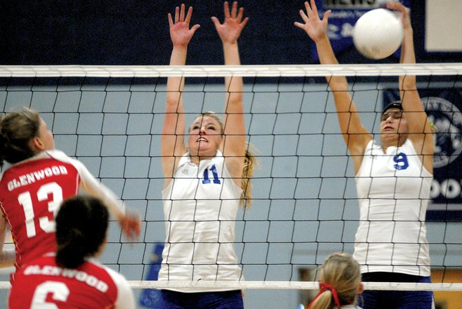 Moffat County High School juniors Natasha Romney, 11, and Sara Kurz, 9, block a spike from visiting Glenwood Springs' Taryn Pearce Friday night. The Bulldogs won in five games.