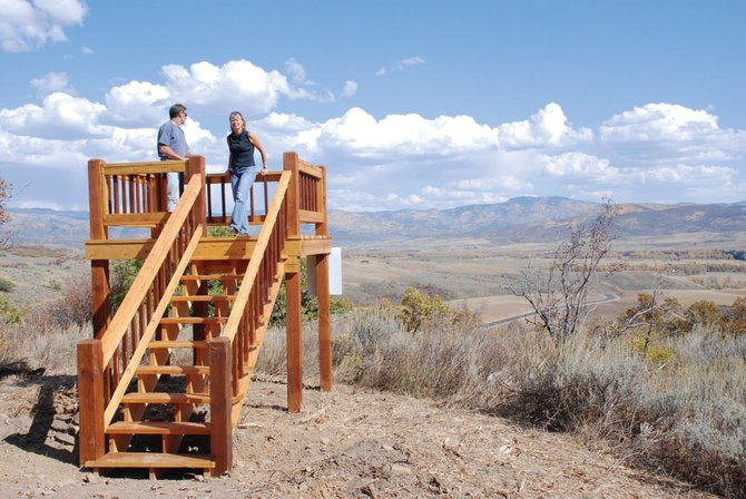 Developer Todd Gilbertson and Listing Broker Sue Stempel, of Romick and Associates, admire the views of Mount Werner from one of the 35-acre building lots at Saddle Ridge.
