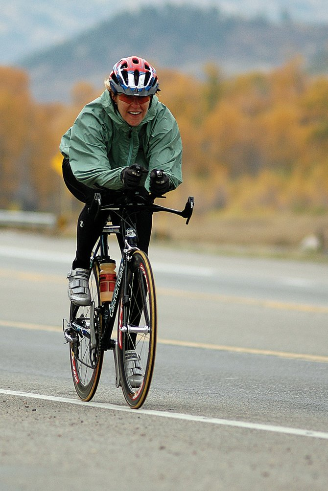 Joy Rasmussen speeds down U.S. Highway 40 on Saturday morning in her final training ride before heading to Hawaii for the IronMan Triathlon. Rasmussen qualified for the event at a race in Europe last year and said she hopes to finish in the top 10 of her age group.