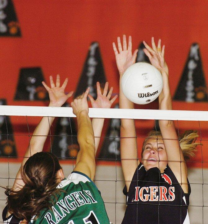 Hayden High School freshman Erin Koehler blocks the ball during Friday night's match against Rangely. Hayden lost the match, winning one of four games.