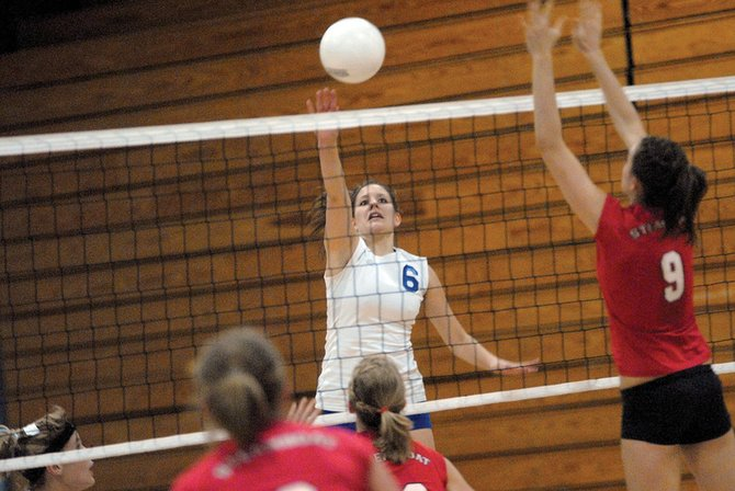 Moffat County High School senior Ariel Sanchez tips the ball over the net Tuesday against visiting Steamboat Springs High School. The Sailors spoiled MCHS' homecoming celebration, defeating the Bulldogs, 25-21, 25-23 and 25-17.