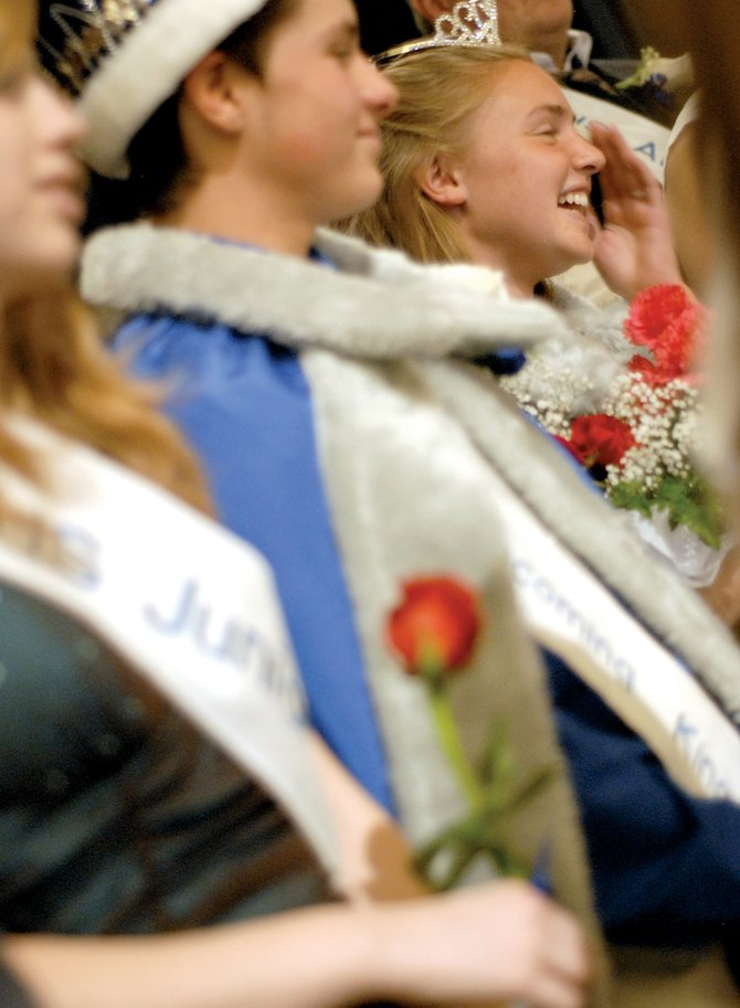 Mychal Beauchamp and Megan Knez react after being crowned Moffat County High School's 2008 homecoming king and queen Thursday.