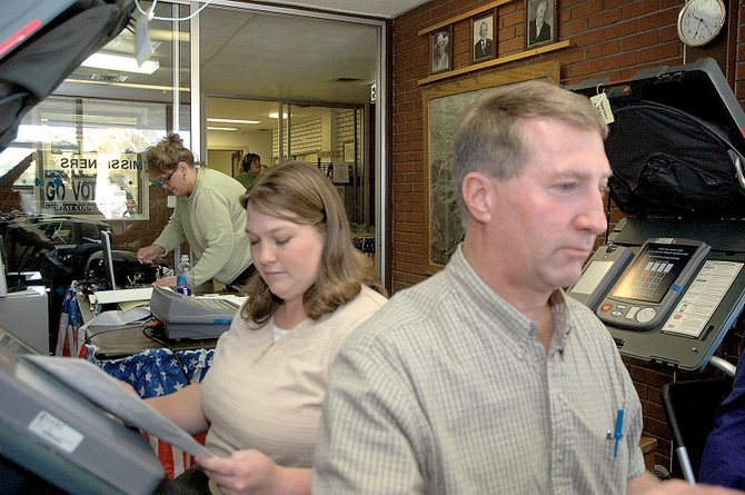 Kristy Loyd, a deputy clerk with the Moffat County Clerk and Recorder's Office, sits to the left of John Ponikvar, a representative for the Moffat County Republican Central Committee, as the two enter test votes into the county's Hart InterCivic voting machines. The Clerk and Recorder's Office conducted a public election test to verify voting-machine accuracy ahead of the Nov. 4 election.