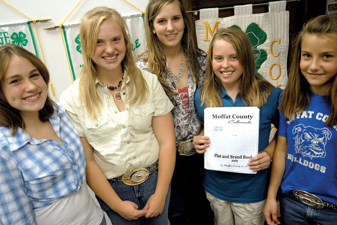 "Members of the 4-H Council, from left, Emily Wellman, Makayla Goodnow, Karissa Maneotis, Alexi Goodnow and Andrea Maneotis hold the ""Moffat County Plat and Brand Book,"" which is being updated and reprinted. The book, which last was printed in 2003, is a fundraising project for the Council that supports activities for the group."
