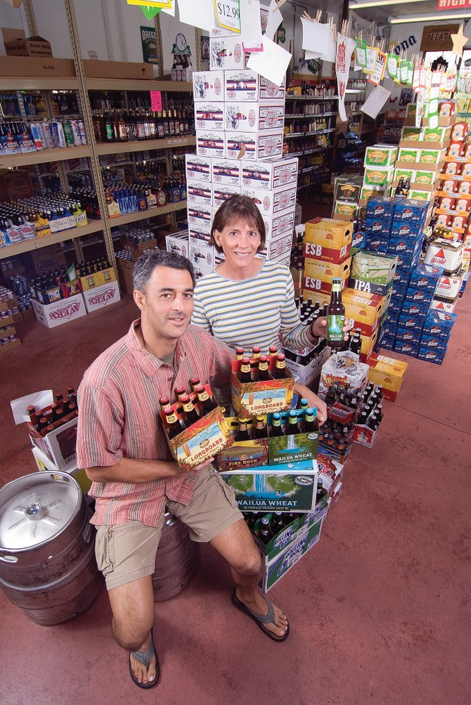 Rich and Wendy Tucciarone may have been cold, but they looked at home inside the beer cooler at Arctic Liquors. The couple was in Steamboat last week and stopped in to check out the store's selection and placement of Kona's bottled beers.