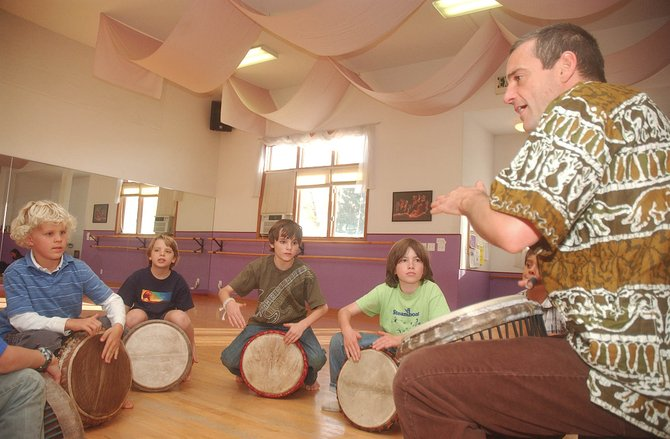 Cary Kamperschroer teaches drumming, rhythms and gumboot dance to, from left, Lucas Rowse, Brandon DeShazer, Kolton Voeltzel and Cole Morgan on Friday at the Northwest Ballet Studio. Late registration for the Boys Only Workshop eight-week series will be open until Oct. 17.