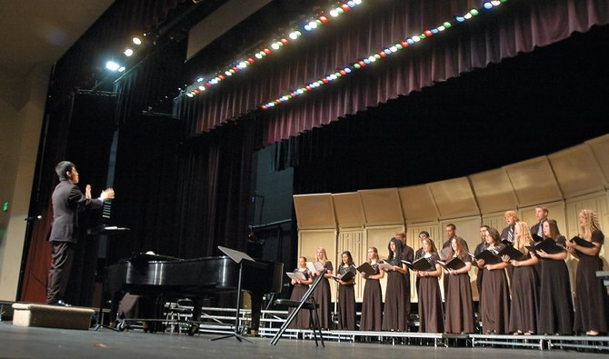 The Moffat County High School choir performs during the Fall Vocal Clinic Concert on Tuesday night at the high school. The event, which featured choirs from eight high schools, gave students experience singing in front of their peers.