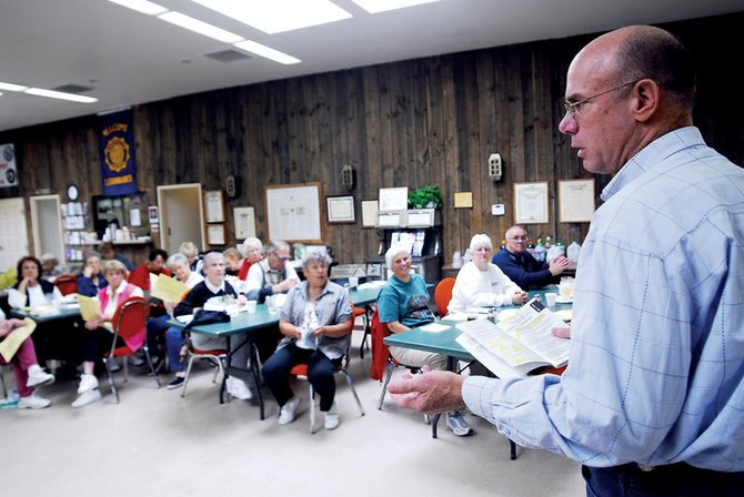 Moffat County Commissioner Tom Gray, along with Craig Mayor Don Jones, explains ballot issues to about 60 Craig residents Wednesday at American Legion Post No. 62. Gray and Jones answered questions from citizens pertaining to the proposed amendments and referendums on the ballot in the general election.