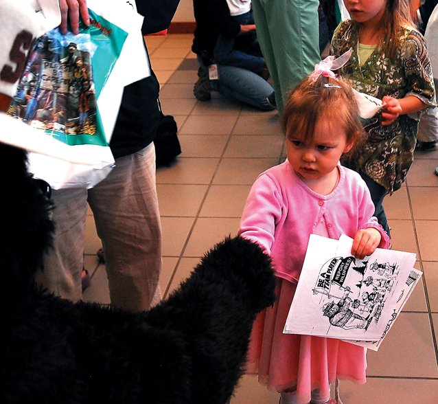 Megan Neton, 5, shakes hands with Smokey Bear on Wednesday afternoon at the Bureau of Land Management Little Snake Field Office. Megan accompanied her two older sisters, Alexa and Molly, to a Girl Scout field trip to the office.