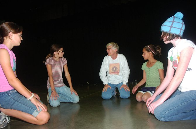 Rusty de Lucia talks to acting students, from left, Caleigh Greene, Lark Skov, Reina Salky and Maggie Carrigan on Tuesday at Steamboat Springs Middle School.
