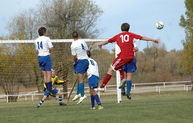 Steamboat Springs High School's Blake Eddington boots a direct kick Thursday at the Moffat County goal. Eddington's goal in the second half helped the Sailors come back from three goals down in the final 10 minutes to tie the Bulldogs.