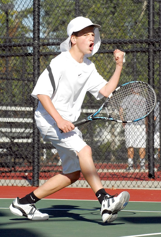 Jack Burger celebrates after winning a point in Thursday's quarterfinal match against Greeley West at Pueblo City Park. Burger and his teammate, Charlie Smith, beat the Greeley team, 6-3, 6-7 and 7-5 (5), to advance to today's semifinal match against Kent Denver.