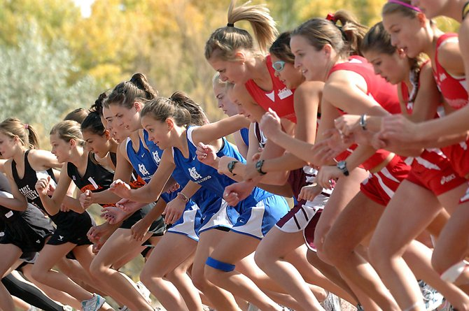 The MCHS girls cross-country team, in blue, takes off at the sound of the starting gun Saturday in the Region 5 championships in Delta. The girls team placed third, qualifying for the upcoming state championships Saturday in Fort Collins.