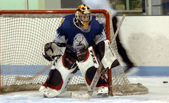 Bulldog netminder Spencer Wayman readies himself for a shot during practice Monday at the Moffat County Ice Arena. The Bulldogs went 2-1-1 during their preseason four-game road trip to Grand Junction.