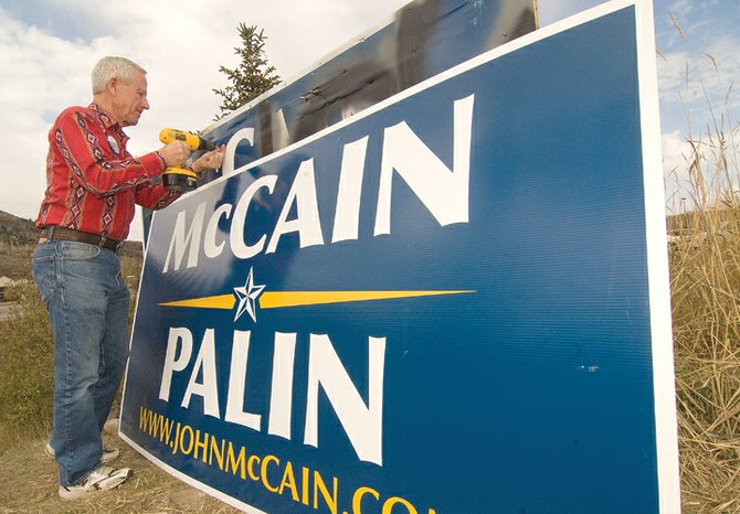 Republican State Sen. Jack Taylor, R-Steamboat Springs, repairs a sign showing the Routt County Republicans' support for candidates John McCain and Sarah Palin in front of an office building on U.S. Highway 40 in Steamboat Springs. The sign has been the target of repeated vandalism. Taylor, and and Vance Halvorson, chairman of the Routt County Republican Central Committee, have replaced or repaired the sign several times in the past couple of weeks.