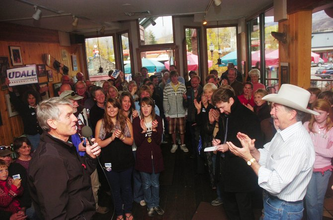 Congressman Mark Udall speaks to supporters during a campaign stop Tuesday at Backcountry Provisions. Udall visited Steamboat Springs on the first day of a tour of the Western Slope with Congressman John Salazar, pictured in front wearing a cowboy hat.
