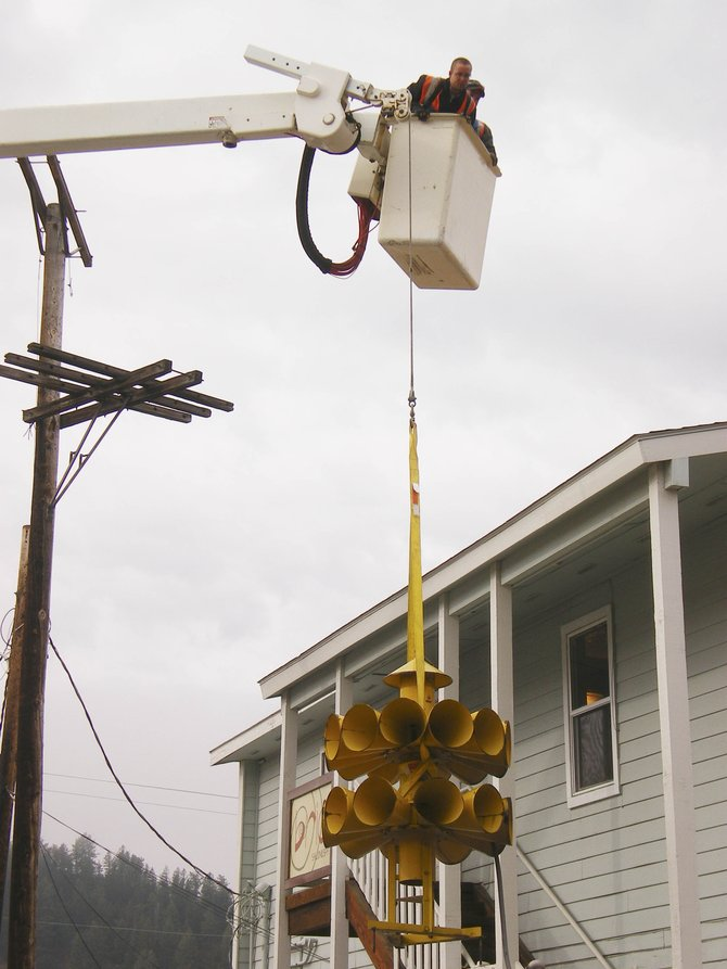 City workers took down the infamous noon siren from its unsturdy perch, a wooden pole near Eighth and Oak streets, Tuesday morning.