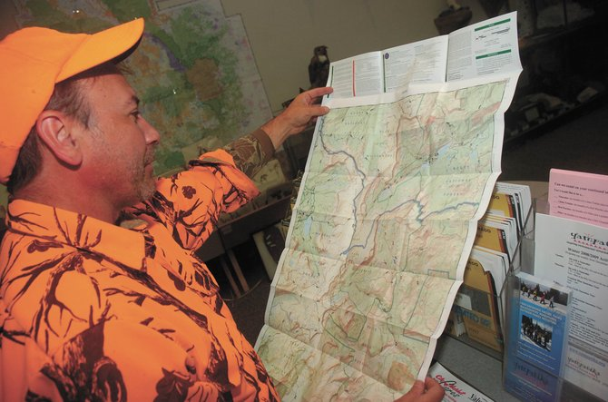 Wisconsin hunter Todd Babcock shops for maps Wednesday at the Steamboat Springs Division of Wildlife Office.
