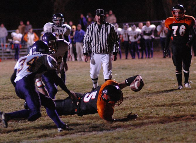 Hayden senior Coy Letlow stretches for the end zone Friday as the Tigers wrapped up their home schedule. Letlow came up a yard short on the play but had little trouble plowing in on the next one. He ran for 115 yards and two scores in the first half as Hayden routed West Grand, 47-12.