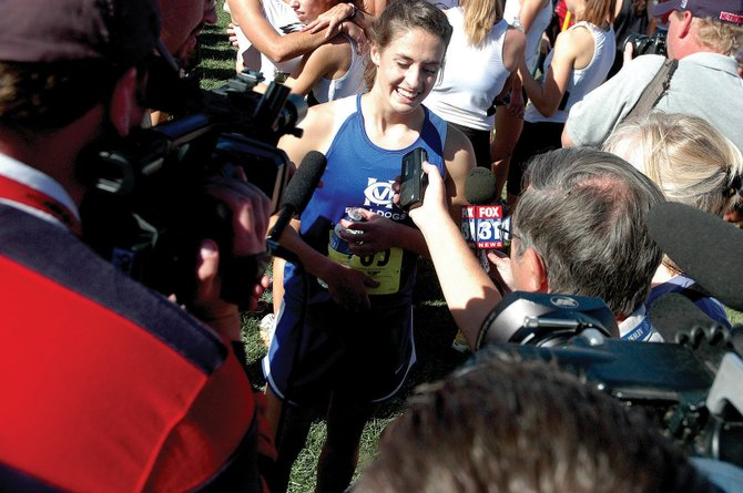 Moffat County senior Alicia Nelson gives a big smile during interviews with media after winning the Class 4A Colorado State Girls Cross Country Championship on Saturday in Fort Collins. Nelson became Moffat County's sixth individual champion and the first in 12 years for the program.