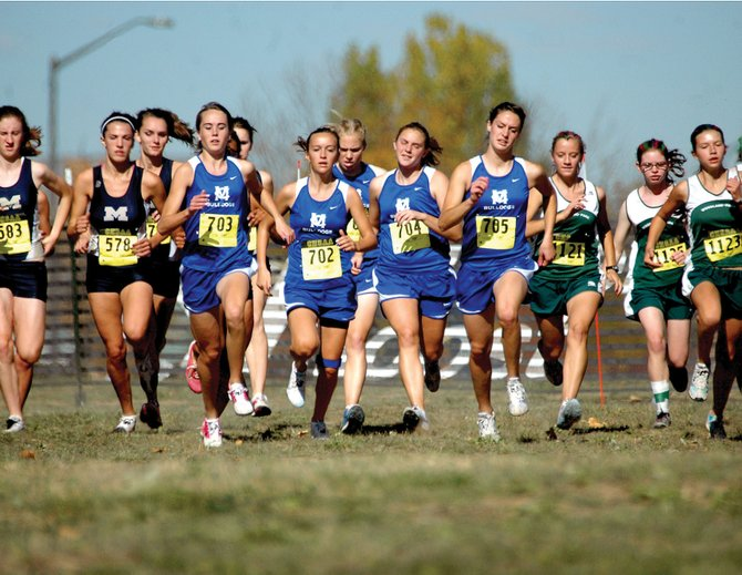 The Moffat County girls team, from left, Maddy Jourgensen, Nike Cleverly, Laura Zirkle, Megan Knez and Alicia Nelson, take off at the beginning of the Class 4A Colorado State Cross Championships on Saturday in Fort Collins. The girls team finished 16th, and the Moffat County boys finished 17th in their races.