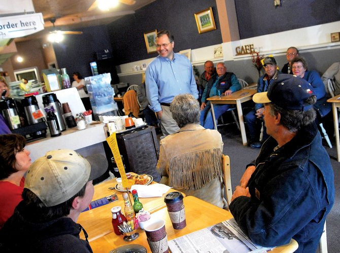Bob Schaffer, Republican U.S. Senate candidate, speaks with local residents Wednesday at Serendipity Coffee Shop. Schaffer spoke to a largely supportive crowd and garnered a spontaneous campaign contribution while answering questions.