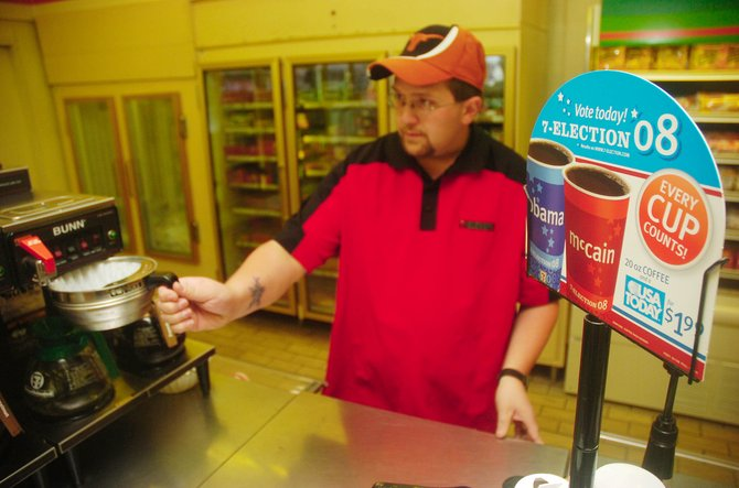 Steamboat Springs 7-11 store employee Jake Goodwin makes coffee Thursday morning at the store, which is participating in the 7-Election 2008 promotion.