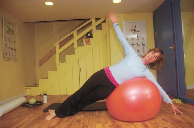 Hayden resident Eva Gibbon earned her Pilates certification and started teaching four years ago. She opened Hayden Pilates in the basement of her home two years ago.