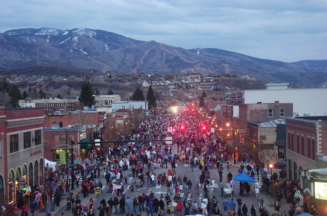 A view from the ladder of a Steamboat Springs Fire Rescue truck shows locals filling Lincoln Avenue on Friday night dressed in costumes during the annual Downtown Halloween Stroll.