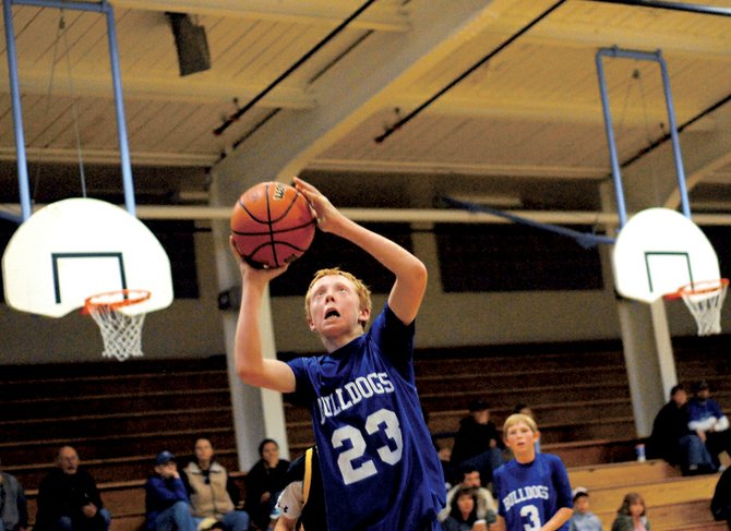 Craig Middle School eighth-grader Wyatt Oberwitte drives in for a layup Saturday against Meeker. The Bulldogs cruised past the visiting Cowboys, 26-12, and improved to 3-0 on the season.