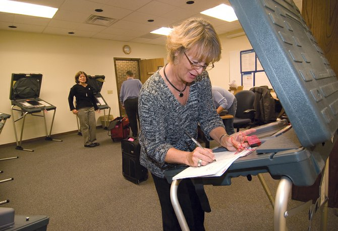 Election official Kim Bonner checks an electronic voting machine while setting up a polling station at the Routt County Courthouse Annex Building. Officials are preparing for a busy Election Day on Tuesday as voters head to the booth to decide who will be the next president of the United States.