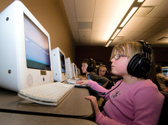 First-grader Lili Hutchinson works in the computer lab at Soda Creek Elementary School on Tuesday afternoon. The half-cent sales tax has been used to fund technology throughout the Steamboat Springs School District.