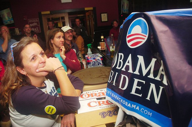 Steamboat Springs Obama supporter Babette Dickson watches televised election coverage Tuesday night at Big House Burgers in Steamboat Springs.