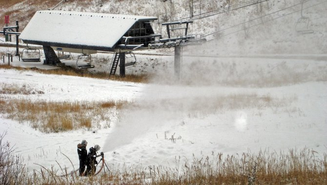 Members of snowmaking crews at Steamboat Ski Area fire up the guns Wednesday morning on Mount Werner. Steamboat saw its first significant snowfall of the season this week and is gearing up for Scholarship Day on Nov. 26.