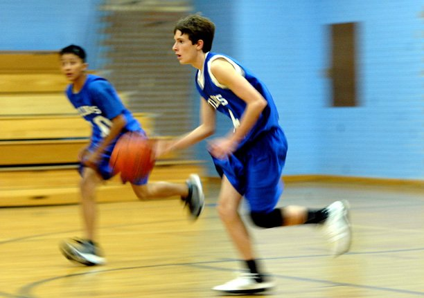 Craig Middle School guard Paul Laliberte dribbles down the court Friday against visiting Steamboat Springs. The Bulldogs dispatched the Sailors, 30-25, to move to a perfect 4-0 on the season.