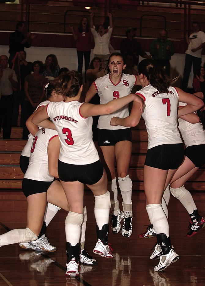 Steamboat Springs High School junior setter Colleen King celebrates with teammates Sept. 10 after defeating Glenwood Springs High School, 3-1. Western Slope League coaches named King the league's MVP. She is the first junior from Steamboat to win the award since former UCLA All-American Katie Carter.