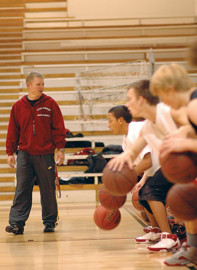 Steamboat Springs High School boys basketball coach Luke DeWolfe keeps an eye on his team Friday during a ball-handling drill. DeWolfe started his first season as head coach of the Sailors on Monday when the preseason basketball camp kicked off. Regular practices start Wednesday afternoon. DeWolfe replaces longtime Steamboat coach Kelly Meek, who retired after last season.