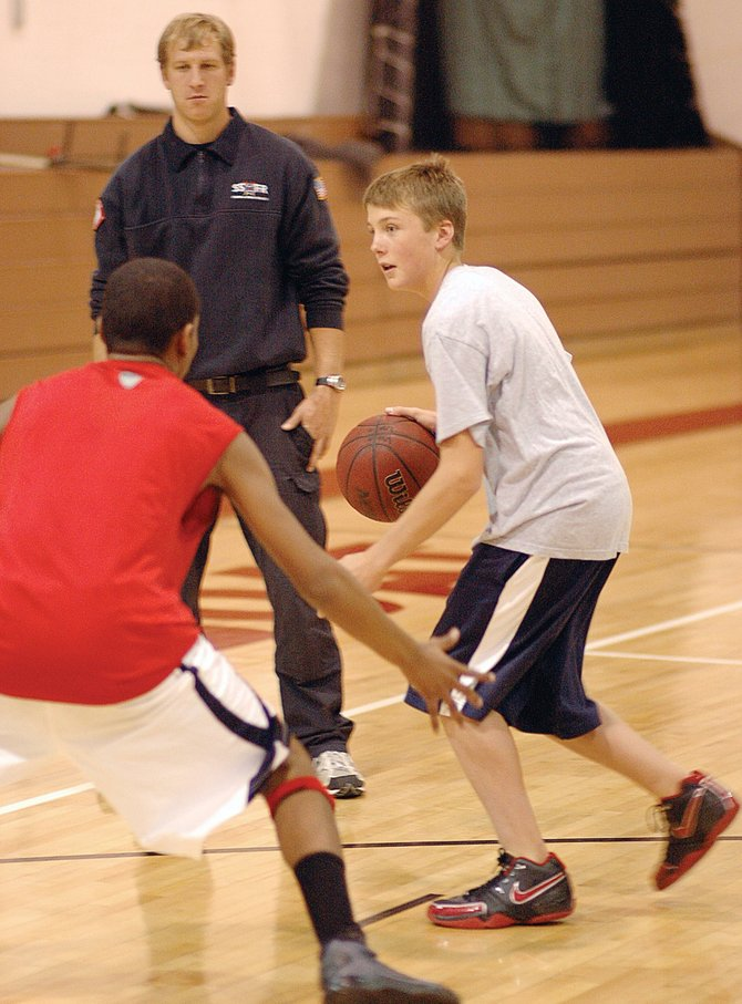 Steamboat Springs High School freshman Jake Miller dribbles the basketball while Randall Nelson plays defense Friday during the team's week-long preseason camp. Winter sports teams across the state will begin official practice Wednesday.