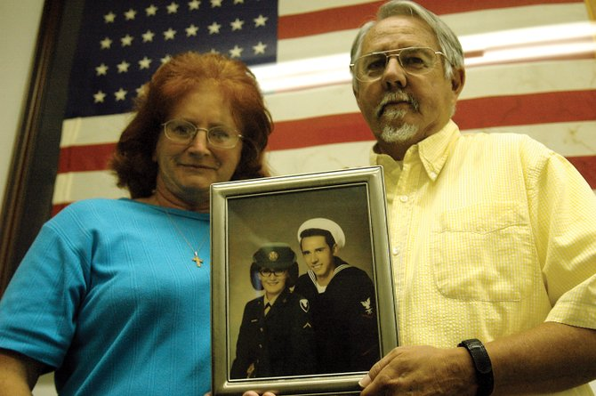 Craig residents Joan Bates, left, and her husband, Harold, pose with a photo of them taken while they were in the military. Joan served in the U.S. Army for about 2 and 1/2 years and Harold served in the U.S. Navy for 20 years. They met at White Sands Missile Range in New Mexico and married in 1968.